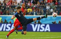 France's Olivier Giroud and Belgium's Vincent Kompany in action during their teams' World Cup semi-final clash. Picture: @fifaworldcup/Facebook.com.