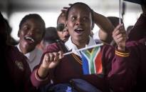 A young school girl waves a little South African flag ahead of President Jacob Zuma's Youth Day address in Ventersdorp on 16 June 2017. Picture: Reinart Toerien/EWN