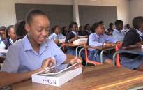 A gauteng pupil smiles as she inpects her new tablet, Picture: Vumani Mkhize/EWN.