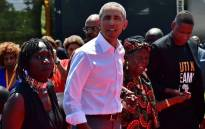 Former US President, Barack Obama (C) with his step-grandmother Sarah (2R) and half-sister, Auma (L) arrive to unveil a plaque on July 16, 2018 during the opening of the Sauti Kuu Resource Centre, founded by his half-sister, Auma Obama at Kogelo in Siaya county, western Kenya. Picture: AFP.