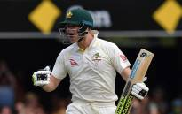 Australia's batsman Steve Smith celebrates his 100-runs on the third day of the first cricket Ashes Test between England and Australia in Brisbane on 25 November 2017. Picture: AFP.
