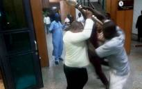 People trying to take possession of the mace, the symbol of authority of Nigeria's Upper Legislative Chamber, seized at the chamber in Abuja, on April 18, 2018. Picture: AFP