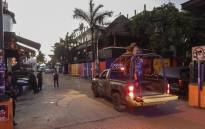 Police and military police agents patrol the area near a nightclub in Playa del Carmen, Quintana Roo state, Mexico where 5 people were killed, three of them foreigners, during a music festival on January 16, 2017. Picture: AFP