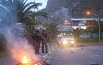 FILE: Public order police monitor the situation in Hangberg after residents protested over fishing quotas. Photo: Bertram Malgas/EWN
