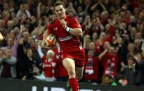 Wales wing George North runs in to score a try during the Six Nations international rugby union match between Wales and Scotland at the Millennium Stadium in Cardiff, south Wales, on 15 March, 2014. Picture: AFP