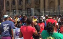 Members of the Treatment Action Campaign (TAC) & Sonke Gender Justice protesting outside court to show their support for ex-miners seeking compensation for contracting silicosis while working underground. Picture: Gia Nicolaides/EWN