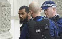 Firearms officers from the British police detain a man near the Houses of Parliament in central London on 27 April 2017 before being taken away by police. Picture: AFP.