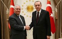 In this handout photograph taken and released by The Turkish Presidential Press Office on 15 February, 2018, Turkish President Recep Tayyip Erdogan shakes hands with US Secretary of State Rex Tillerson ahead of a meeting at the Presidential Complex in Ankara. Picture: AFP.