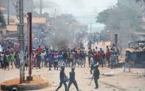 Protesters clash with anti-riot police in a street in Conakry, Guinea on 13 March 13, 2018 during a demonstration against President Alpha Conde. Demonstrators erected roadblocks and set fire to tyres, during the protest. Picture: AFP