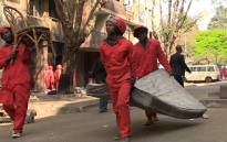 FILE: Members of the Red Ants clear people's belongings from a dilapidated building. Picture: EWN.