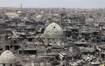 FILE: A picture taken on 9 July 2017 shows a general view of the destruction in Mosul's Old City. Picture: AFP