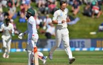 New Zealand's Trent Boult (R) celebrates South Africa's Temba Bavuma being caught during day two of the 1st International cricket Test match between New Zealand and South Africa at the University Oval in Dunedin on 9 March, 2017. Picture: AFP.