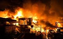 A fire burns through an informal settlement as it burns hundreds of houses in Delpan, Tondo, Manila on February 7, 2017. Picture: AFP