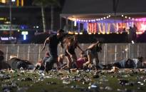 People run from the Route 91 Harvest country music festival after apparent gun fire was heard on 1 October 2017 in Las Vegas, Nevada. Picture: AFP