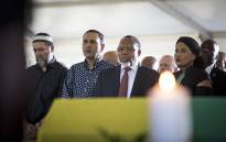 Former President Kgalema Motlanthe sings the national anthem next to the coffin of Ahmed Kathrada at his funeral on 29 March 2017. Picture: Reinart Toerien/EWN.