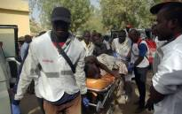 FILE: A wounded person is carried on a stretcher in Mora, following suicide attacks in the border city of Kerawa, northern Cameroon. Picture: AFP