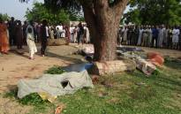 People gather on 12 July 2017 on the scene of an attack by suicide bombers in Maiduguri on July 11 2017. Picture: AFP.
