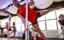 EWN sports reporter Marc Lewis feels the burn during a pole dancing class. Picture: Thomas Holder/EWN