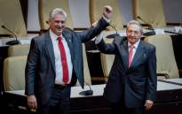 Outgoing Cuban President Raul Castro (R) raises the arm of Cuba's new President Miguel Diaz-Canel after he was formally named by the National Assembly, in Havana on 19 April 2018. Picture: AFP.