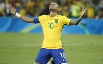 FILE: Brazil's forward Neymar celebrates scoring a goal. Picture: AFP