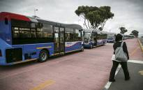 FILE: A pedestrian passes by the line of MyCiti Buses parked as part of the protest in the red designated bus lane. Picture: Thomas Holder/EWN