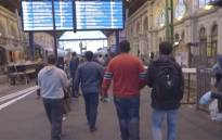 FILE: Thousands of refugees and migrants fleeing violence in Syria and Iraq are enduring long waits and cramped conditions as they try to board trains bound for Austria and Germany. Picture : Screengrab/CNN