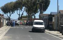 Police at Begonia Street in Mitchells Plain where a murder-suicide took place involving a Cape Town police officer. Picture: Shamiela Fisher/EWN