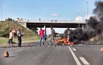 FILE: Protesters from Top Village township blocking the main road leading into Mahikeng during protests against Premier Supra Mahumapelo. Picture: Ihsaan Haffejee/EWN.