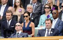 David and Victoria Beckham sit next to Samuel L. Jackson during the Wimbledon men's singles final on 6 July. Picture: Facebook.