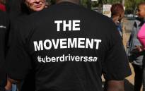 An Uber driver protests at the head office in Parktown North.  Picture: Christa Eybers/EWN