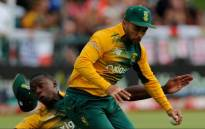 JP Duminy holds onto the ball despite colliding with Kagiso Rabada to take the wicket of Alex Hales of England during the 1st T20 International match between South Africa and England on 19 February 2016. Picture: Cricket South Africa (CSA) via Facebook.