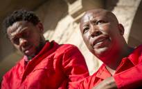 EFF leader Julius Malema (R) and party spokesman Mbuyiseni Ndlozi (L) wait to address supporters and journalists after being forcibly removed from Parliament again on 17 May 2016. Picture: Aletta Harrison/EWN