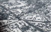 An aerial picture shows snow covered houses in a southern suburb of Paris near Orly on 7 February 2018 following heavy snowfall in the Paris area. Picture: AFP