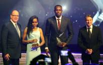 Prince Albert II of Monaco, Jamaican athlete Usain Bolt, Ethiopian athlete Almaz Ayana and IAAF President Sebastian Coe pose after Ayana and Bolt were awarded best female and male athlete of the year 2016 in Monaco on 2 December, 2016 during the International Association of Athletics Federations (IAAF) gala. Picture: AFP.