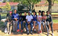 Matriculants at Mondeor High School waiting to collect their results outsisde the school premises. Picture: Katleho Sekhotho/EWN