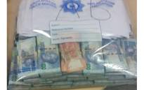 Some of the R10 million a South African man was caught trying to smuggle into Dubai. Picture: SAPS.