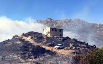 A fire destroyed three structures after a blaze broke out between Pringle Bay and Rooi Els on 19 March 2017. Picture: @OverbergFPA/Twitter