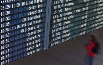 A display shows cancelled flights and a strike information during a strike of pilots of the German airline Lufthansa at the Lufthansa terminal of the Franz-Josef-Strauss-airport in Munich, southern Germany. Picture: AFP
