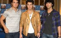 (L-R) Kevin Jonas, Nick Jonas and Joe Jonas present Jonas Brothers new album 'Lines, Vines & Trying Times', at the Ritz Hotel on 13 June 2009 in Madrid, Spain. Picture: Getty Images