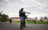 Public order police stand ready with shotguns and rubber bullets as students protest at CPUT. Picture: Bertram Malgas/EWN