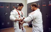 Prime crew of the first manned Skylab mission scientist-astronaut Joseph P Kerwin (L) and astronaut Paul J Weitz (R) assist each other in suiting up in Building 5 at Nasa's Johnson Space Center in Houston. Picture: www.nasa.gov.