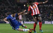 Chelsea's Brazilian-born Spanish striker Diego Costa (L) vies with Sunderland's French-born Ivorian defender Lamine Kone as the ball hits him from behind during the English Premier League football match between Sunderland and Chelsea. Picture: AFP.