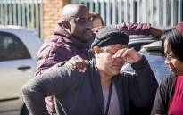 An emotional Colleen Duister wipes a tear from her face while her partner puts his hand on her shoulder outside the Germiston pathology laboratory where they have waited for a week for the body of their three-year-old child due to the forensic workers' strike. Picture: Reinart Toerien/EWN