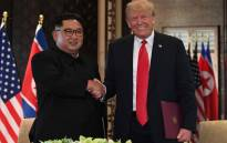 FILE: North Korea's Kim Jong Un shakes hands with US President Donald Trump during their summit meeting in Singapore on 12 June 2018. Picture: AFP.