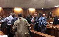 Eight former cops say goodbye to their families after being sentenced to 15 years each on 11 November 2015 for killing Mido Macia. Picture: Masego Rahlaga/EWN