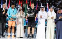 World number one Andy Murray (C) of Great Britain and Spain's Fernando Verdasco celebrate with their respective first and second-place trophies after the conclusion of their ATP final tennis match during the Dubai Duty Free Championships. Picture: AFP.