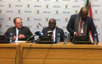 Sports Minister Thulas Nxesi (centre) joined by deputy Sports Minister Gert Oosthuizen (left) & Director-General Alec Moemi (right) during a media briefing. Picture: EWN Sport