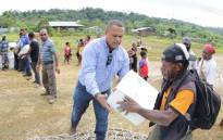An undated handout photo received on 5 March from Oil Search Limited shows Oil Search staff helping locals distribute supplies from Oil Search and the Australian government in Papua New Guinea. Picture: AFP