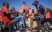 SACP members sing and dance outside National Treasury in Pretoria on 21 April 2017 against what it calls the capture of South Africa's finance sector. Picture: Reinart Toerien/EWN.