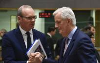 FILE: European Union Chief Negotiator in charge of Brexit negotiations, Michel Barnier (R) talks with Irish Foreign Minister Simon Coveney during a General affairs council debate on the article 50 concerning Brexit at the EU headquarters in Brussels on 27 February 2018. Picture: AFP